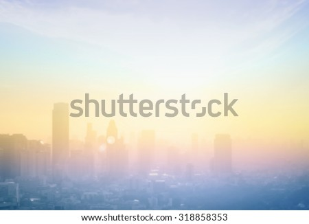 Vintage style. Blurred colorful rainbow sunset over city background with circle light. Blur background concept. - stock photo