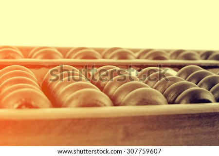 Vintage style - Close up of a wooden abacus beads. Selective focus, shallow depth of field. Wooden abacus - stock photo