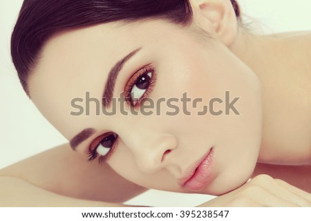 Vintage style close-up portrait of young beautiful woman with stylish make-up - stock photo