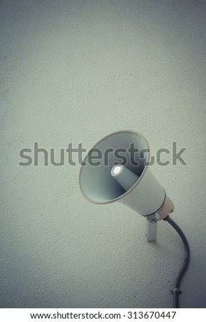 Vintage style color loudspeaker setting on the wall for present News in public place - stock photo