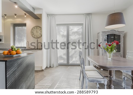 Vintage style dining hall in new cozy kitchen - stock photo