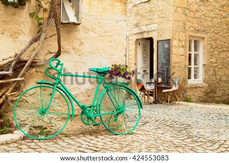 Vintage Style Green Painted Bicycle in Alacati Streets - stock photo