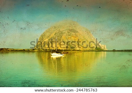 Vintage style image of Morro Rock in the early morning lights, Morro Bay, California - stock photo