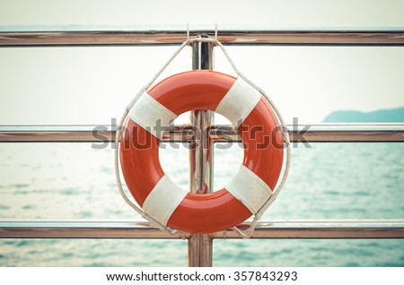 Vintage style photo of life preserver attached to the cruise ship - stock photo