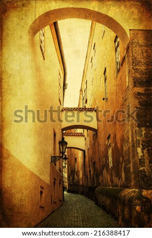 vintage style picture of a picturesque old alley in the UNESCO protected historic city centre of Prague, Czechia - stock photo