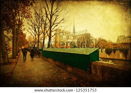 vintage style picture of Paris with closed stalls along the river Seine and the famous church Notre Dame in the background - stock photo