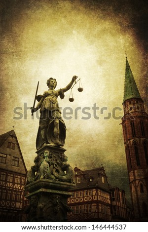 vintage style picture of the famous Justitia statue in Frankfurt, Germany - stock photo
