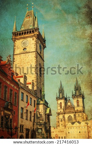vintage style picture of the historical City Hall Tower with the famous astromical clock and Church of Our Lady before Tyn at the Old Town Square in Prague, Czechia  - stock photo
