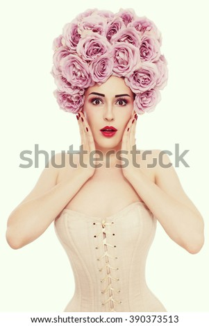 Vintage style portrait of young beautiful slim woman in corset with fancy roses wig on her head and shocked expression  - stock photo