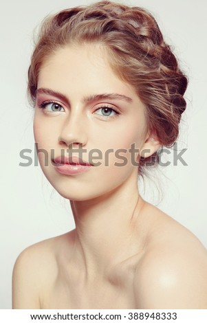Vintage style portrait of young beautiful smiling healthy girl with clean make-up and braids - stock photo