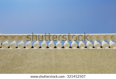 Vintage style railing on the roof. View from below. - stock photo
