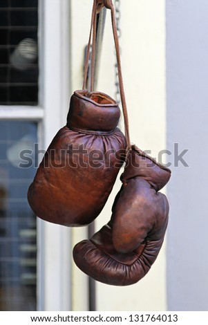 Vintage style real brown leather boxing gloves - stock photo