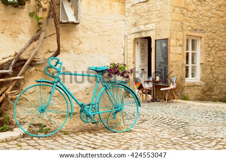 Vintage Style Turqouise Painted Bicycle in Alacati Streets - stock photo