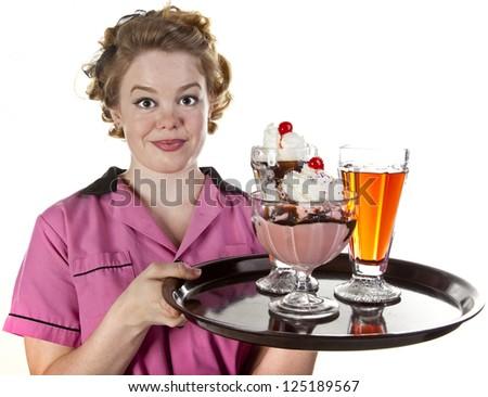 Vintage style waitress or female server serving an ice cream sundae and sodas  isolated on white. - stock photo