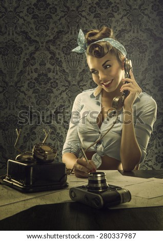 Vintage style - Woman talking on the phone with retro dial phone - stock photo