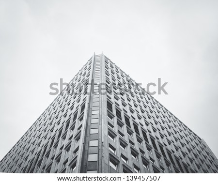 Vintage styled highrise under moody skies - stock photo