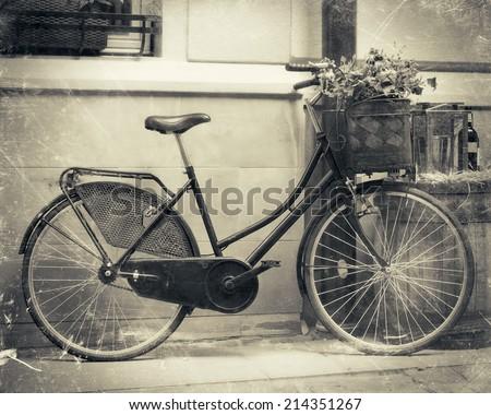 Vintage stylized photo of Old bicycle - stock photo