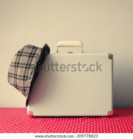 Vintage suitcase and hat  - stock photo