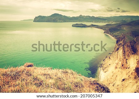 vintage summer seascape with mountaine and waves, natural background - stock photo
