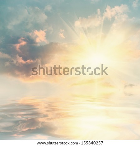 Vintage sunset over sea with reflection in water - stock photo