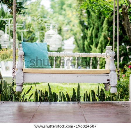 vintage swing and blue pillow - stock photo