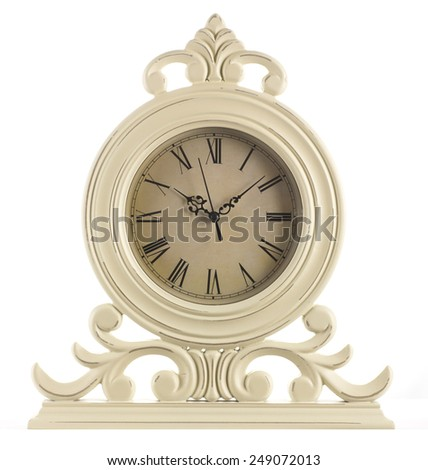 vintage table clock on a white background - stock photo