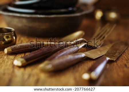 Vintage tableware, cutlery on dark brown wooden backround - stock photo