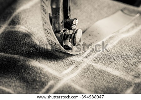 Vintage tailor machine with scissors, cloth and threads - stock photo
