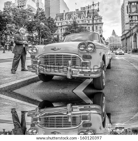 Vintage taxi in New York streets with reflections - stock photo