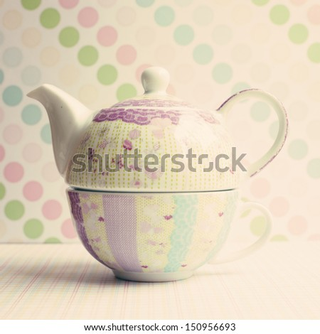 Vintage teapot and cup  - stock photo