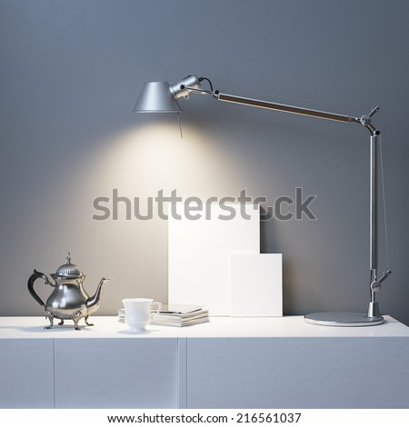 Vintage Teapot And Empty Frames Under The Lamp - stock photo