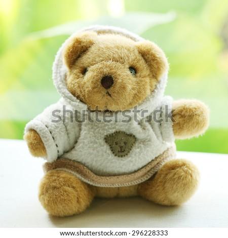 Vintage teddy bear In sweaters - stock photo