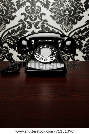 Vintage telephone at the desk - stock photo