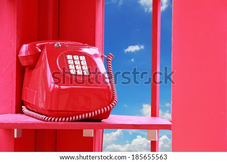 vintage Telephone box with blue sky. - stock photo