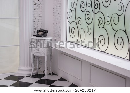 Vintage telephone for decoration in a white room - stock photo