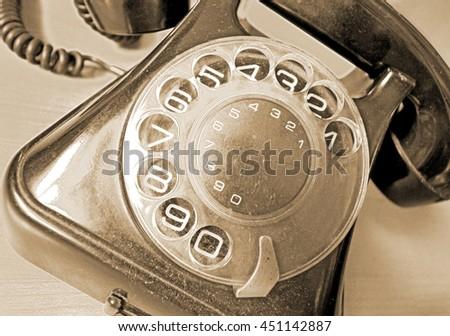 Vintage telephone in sepia  - stock photo