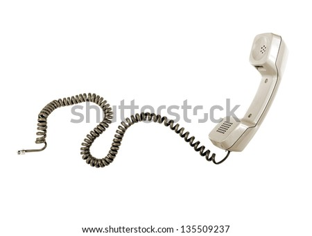 Vintage telephone receiver with cable isolated over white - stock photo