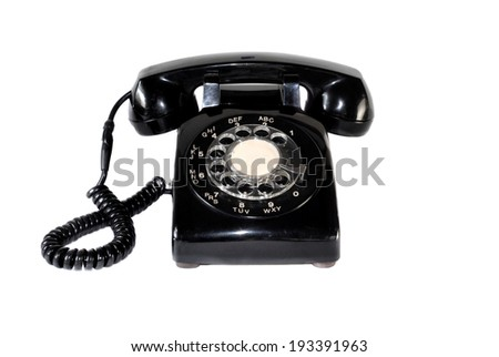 Vintage telephone with scuffs and scratches isolated on white.  The telephone has a traditional North American rotary dial with associative lettering, originally used for dialing named exchanges. - stock photo