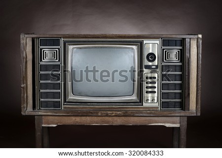 Vintage television on brown background - stock photo