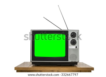 Vintage television on wood table isolated on white with chroma key green screen. - stock photo
