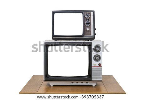 Vintage television stack on old wood table isolated on white with cut out screens. - stock photo