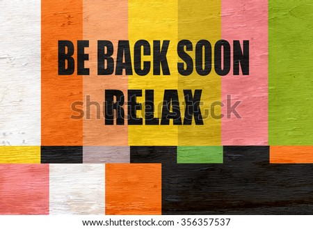 vintage television test pattern with relax message on wood grain texture - stock photo