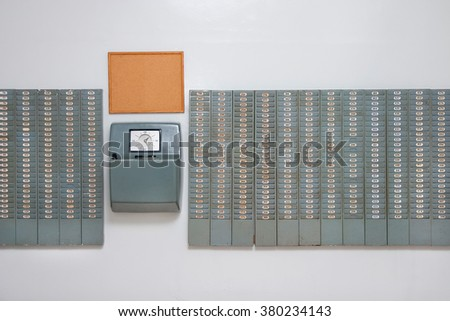 Vintage time working punching card wall, from the 60s and 70s - stock photo