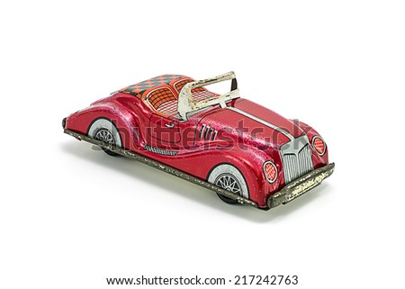 vintage tin car toy isolated on white.  - stock photo