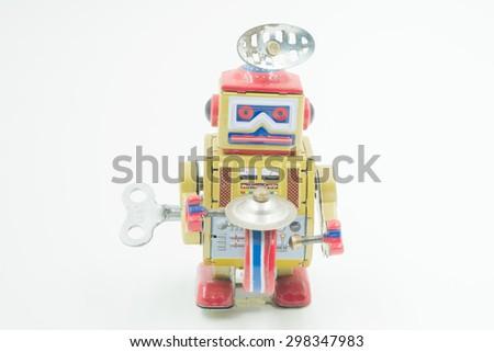 Vintage tin toy robot white background - stock photo