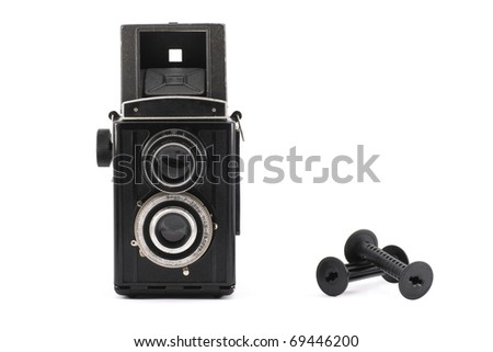 Vintage TLR photo camera from fifties with two film reels isolated on white - stock photo