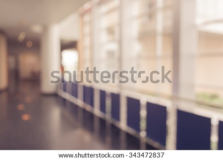 vintage tone blur image of hospital hallway for medical background. - stock photo