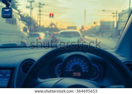 vintage tone blur image of inside car with bokeh on day time for background usage. - stock photo