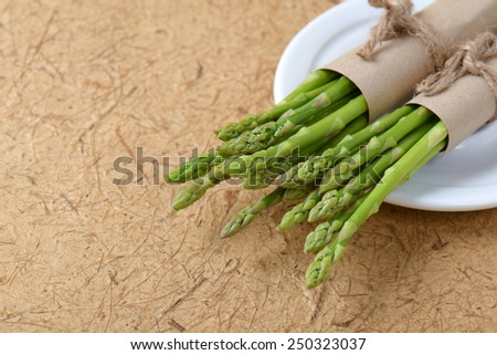 Vintage tone, Bunch of fresh asparagus on wooden table - stock photo