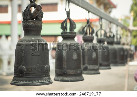 Vintage tone holy bell of ceremony in temple of Thailand - stock photo
